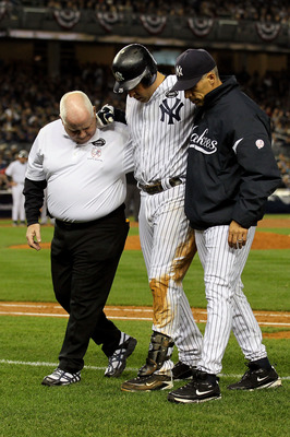 NEW YORK - OCTOBER 19:  Mark Teixeira #25 of the New York Yankees is helped off of the field by Manager Joe Girardi and a trainer after hurting himself while playing against the Texas Rangers in Game Four of the ALCS during the 2010 MLB Playoffs at Yankee