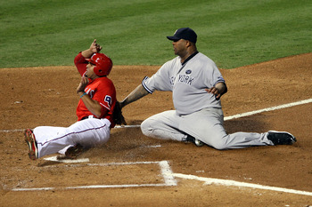 ARLINGTON, TX - OCTOBER 15:  CC Sabathia #52 of the New York Yankees tags out Nelson Cruz #17 of the Texas Rangers at the plate in Game One of the ALCS during the 2010 MLB Playoffs at Rangers Ballpark in Arlington on October 15, 2010 in Arlington, Texas.