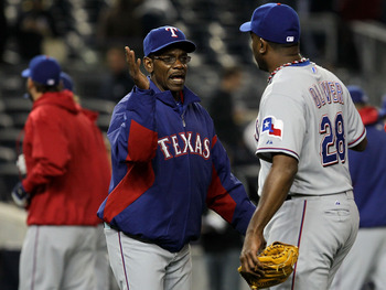 NEW YORK - OCTOBER 19:  (L-R) Manager Ron Washington and Darren Oliver #28 of the Texas Rangers celebrate after the Rangers won 10-3 against the New York Yankees  in Game Four of the ALCS during the 2010 MLB Playoffs at Yankee Stadium on October 19, 2010
