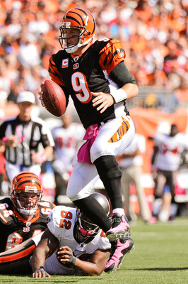 CINCINNATI, OH - OCTOBER 10: Quarterback Carson Palmer #9 of the Cincinnati Bengals scrambles against the Tampa Bay Buccaneers at Paul Brown Stadium on October 10, 2010 in Cincinnati, Ohio. (Photo by Jamie Sabau/Getty Images)