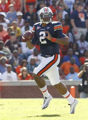 AUBURN, AL - OCTOBER 16:  Quarterback Cam Newton #2 of the Auburn Tigers rolls out and looks downfield for a receiver during the game against the Arkansas Razorbacks at Jordan-Hare Stadium on October 16, 2010 in Auburn, Alabama.  (Photo by Mike Zarrilli/G