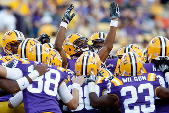 BATON ROUGE, LA - OCTOBER 16:  Members of the Louisiana State University Tigers warm up before playing the McNeese State Cowboys at Tiger Stadium on October 16, 2010 in Baton Rouge, Louisiana.  (Photo by Chris Graythen/Getty Images)