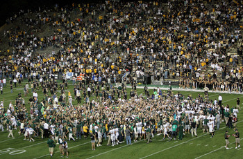 BOULDER, CO - SEPTEMBER 06:  Colorado State fans rush the field to celebrate with the Colorado State Rams after they defeated the Colorado Buffaloes 23-17 at Folsom Field on September 6, 2009 in Boulder, Colorado.  (Photo by Doug Pensinger/Getty Images)