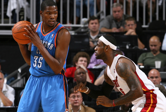 KANSAS CITY, MO - OCTOBER 8: Kevin Durant #35 of the Oklahoma City Thunder looks to drive past LeBron James #6 of the Miami Heat before the game on October 8, 2010 at the Sprint Center in Kansas City, Missouri.  NOTE TO USER: User expressly acknowledges a