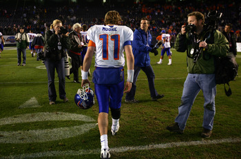 SAN DIEGO, CA - DECEMBER 23:  Quarterback Kellen Moore #11 of the Boise State Broncos walks off the field after his team's 17-16 loss to the TCU Horned Frogs during the San Diego County Credit Union Poinsettia Bowl at Qualcomm Stadium on December 23, 2008