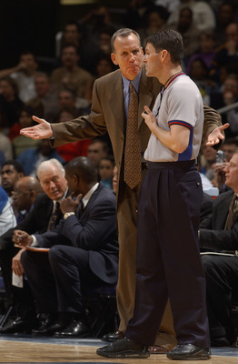 WASHINGTON - FEBRUARY 23:  Head coach Doug Collins of the Washington Wizards reacts to a call by referee Scott Foster #48 during the game at MCI Center on February 23, 2003 in Washington, D.C.  The Mavericks won in overtime 106-101.  NOTE TO USER: User ex