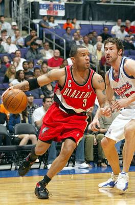 LOS ANGELES - MARCH 7:  Damon Stoudamire #3 of the Portland Trail Blazers drives to the basket past Marko Jaric #20 of the Los Angeles Clippers during the game at Staples Center on March 7, 2004 in Los Angeles, California.  NOTE TO USER: User expressly ac