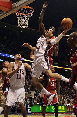 EAST RUTHERFORD, NJ - MARCH 03:  Devin Harris #34 of the New Jersey Nets drives to the hoop against the Cleveland Cavaliers at the Izod Center on March 3, 2010 in East Rutherford, New Jersey.NOTE TO USER: User expressly acknowledges and agrees that, by do