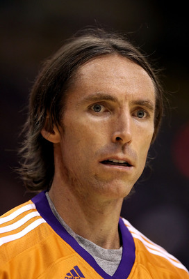 PHOENIX - OCTOBER 12:  Steve Nash #13 of the Phoenix Suns warms up before the preseason NBA game against the Utah Jazz at US Airways Center on October 12, 2010 in Phoenix, Arizona. NOTE TO USER: User expressly acknowledges and agrees that, by downloading