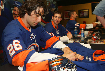 UNIONDALE, NY - JUNE 25: Matt Moulson #26 and John Tavares #91 sign autographs during the New York Islanders Draft Day Party on June 25, 2010 at Nassau Coliseum in Uniondale, New York.  (Photo by Mike Stobe/Getty Images for New York Islanders)