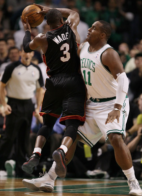 BOSTON - APRIL 27:  Glen Davis #11 of the Boston Celtics tries to stop Dwyane Wade #3 of the Miami Heat from scoring during Game Five of the Eastern Conference Quarterfinals of the 2010 NBA playoffs at the TD Garden on April 27, 2010 in Boston, Massachuse