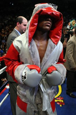 LAS VEGAS - DECEMBER 08:  Floyd Mayweather Jr. enters the ring before taking on Ricky Hatton of England prior to their WBC world welterweight championship fight at the MGM Grand Garden Arena on December 8, 2007 in Las Vegas, Nevada.  (Photo by Al Bello/Ge