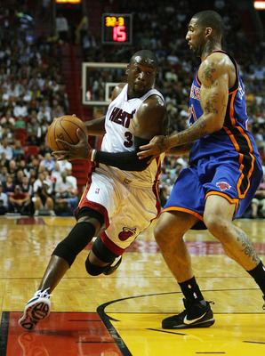 MIAMI - OCTOBER 28:  Dwyane Wade #3 of the Miami Heat drives past Wilson Chandler #21 of the New York Knicks at AmericanAirlines Arena on October 28, 2009 in Miami, Florida. NOTE TO USER: User expressly acknowledges and agrees that, by downloading and/or