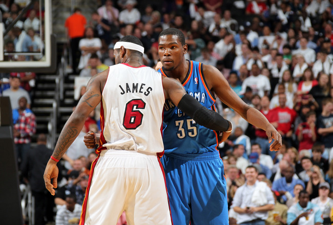 KANSAS CITY, MO - OCTOBER 8: Kevin Durant #35 of the Oklahoma City Thunder hugs LeBron James #6 of the Miami Heat before the game on October 8, 2010 at the Sprint Center in Kansas City, Missouri.  NOTE TO USER: User expressly acknowledges and agrees that,