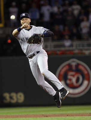 MINNEAPOLIS - OCTOBER 06:  Derek Jeter #2 of the New York Yankees sends the ball to first for the out against the Minnesota Twins during game one of the ALDS on October 6, 2010 at Target Field in Minneapolis, Minnesota. The Yankees defeated the Twins 6-4.