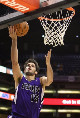 PHOENIX - OCTOBER 20:  Omri Casspi #18 of the Sacramento Kings lays up a shot against the Phoenix Suns during the NBA preseason game at US Airways Center on October 20, 2009 in Phoenix, Arizona. The Suns defeated the Kings 143-127.  NOTE TO USER: User exp