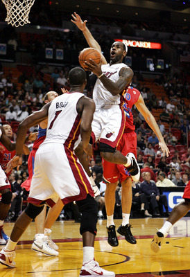 MIAMI - OCTOBER 12:  Forward LeBron James #6 scors and Chris Bosh #1 looks on of the Miami Heat CSKA Moskow on October 12, 2010 in Miami, Florida.  NOTE TO USER: User expressly acknowledges and agrees that, by downloading and or using this photograph, Use