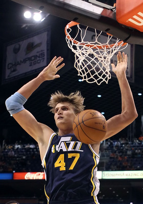 PHOENIX - OCTOBER 12:  Andrei Kirilenko #47 of the Utah Jazz slam dunks the ball during the preseason NBA game against the Phoenix Suns at US Airways Center on October 12, 2010 in Phoenix, Arizona. NOTE TO USER: User expressly acknowledges and agrees that