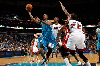NEW ORLEANS - OCTOBER 13:  Trevor Ariza #1 of the New Orleans Hornets shoots the ball over Chris Bosh #1 of the Miami Heat at the New Orleans Arena on October 13, 2010 in New Orleans, Louisiana. NOTE TO USER: User expressly acknowledges and agrees that, b