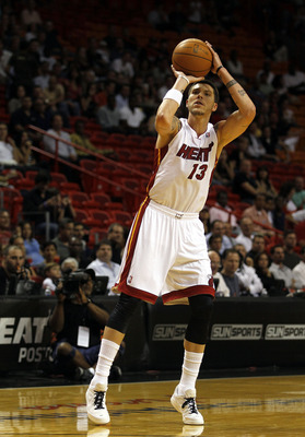 MIAMI - OCTOBER 18:  Forward Mike Miller #13 of the Miami Heat shoots against the Charlotte Bobcats on October 18, 2010 at American Airlines Arena in Miami, Florida. NOTE TO USER: User expressly acknowledges and agrees that, by downloading and/or using th
