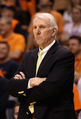 PHOENIX - MAY 03:  Head coach Gregg Popovich of the San Antonio Spurs reacts during Game One of the Western Conference Semifinals of the 2010 NBA Playoffs against the Phoenix Suns at US Airways Center on May 3, 2010 in Phoenix, Arizona. The Suns defeated