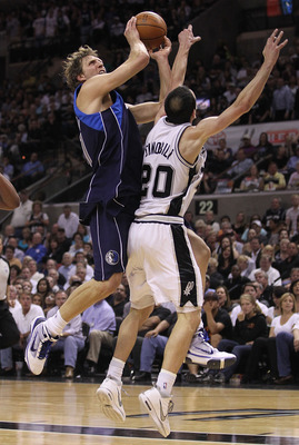 SAN ANTONIO - APRIL 29:  Forward Dirk Nowitzki #41 of the Dallas Mavericks takes a shot against Manu Ginobili #20 of the San Antonio Spurs in Game Six of the Western Conference Quarterfinals during the 2010 NBA Playoffs at AT&T Center on April 29, 2010 in