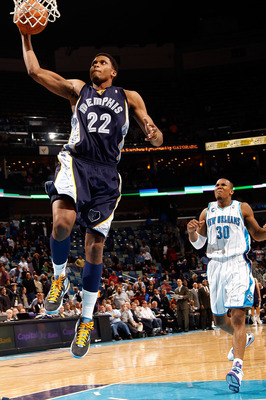 NEW ORLEANS - MARCH 03:  Rudy Gay #22 of the Memphis Grizzlies dunks the ball over David West #30 of the New Orleans Hornets to end the game at the New Orleans Arena on March 3, 2010 in New Orleans, Louisiana.  The Grizzlies defeated the Hornets 104-100.