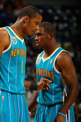 NEW ORLEANS - OCTOBER 13:  Trevor Ariza #1 and Chris Paul #3 of the New Orleans Hornets in action during the game against the Miami Heat at the New Orleans Arena on October 13, 2010 in New Orleans, Louisiana.  NOTE TO USER: User expressly acknowledges and