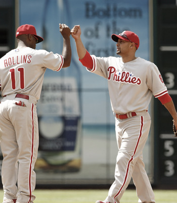 HOUSTON - APRIL 11:  Shane Victorino #8 of the Philadelphia Phillies high fives Jimmy Rollins #11 after defeating the Houston Astros 2-1 at Minute Maid Park on April 11, 2010 in Houston, Texas.  (Photo by Bob Levey/Getty Images)