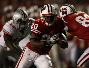 MADISON, WI - OCTOBER 16: James White #20 of the Wisconsin Badgers rushes for a touchdown against the Ohio State Buckeyes at Camp Randall Stadium on October 16, 2010 in Madison, Wisconsin. Wisconsin defeated Ohio State 31-18. (Photo by Jonathan Daniel/Get