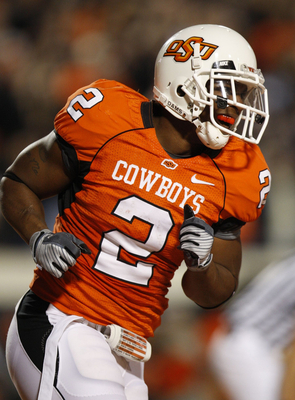 STILLWATER, OK - OCTOBER 31:  Running back Beau Johnson #2 of the Oklahoma State Cowboys celebrates his touchdown in the second quarter of the game against the Texas Longhorns at Boone Pickens Stadium on October 31, 2009 in Stillwater, Oklahoma.  (Photo b