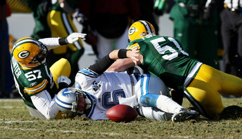 GREEN BAY, WI - DECEMBER 28: Dan Orlovsky #6 of the Detroit Lions looses the ball after being tackled by Jason Hunter #57 and Brady Poppinga #51 of the Green Bay Packers on December 28, 2008 at Lambeau Field in Green Bay, Wisconsin. The Packers defeated t
