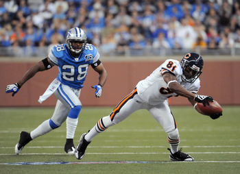 DETROIT - OCTOBER 05:  Rashied Davis #81 of the Chicago Bears makes a reception in front of Leigh Bodden #28 of the Detroit Lions during the third quarter at Ford Field on October 5, 2008 in Detroit, Michigan.  The Bears won 34-7.  (Photo by Harry How/Get