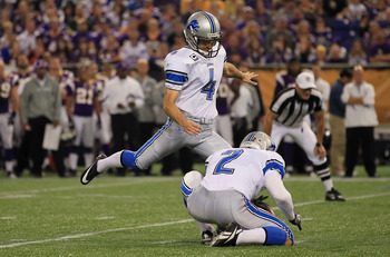 MINNEAPOLIS - SEPTEMBER 26:  Kicker Jason Hanson #4 of the Detroit Lions kicks as place kicker Nick Harris #2 holds against the Minnesota Vikings at Mall of America Field on September 26, 2010 in Minneapolis, Minnesota.  (Photo by Jeff Gross/Getty Images)