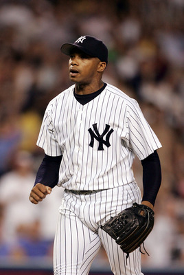 NEW YORK - SEPTEMBER 22:  Orlando Hernandez #26 of the New York Yankees reacts after striking out the side with bases loaded in the third inning against the Toronto Blue Jays September 22, 2004 at Yankee Stadium in the Bronx, New York.  (Photo by Al Bello