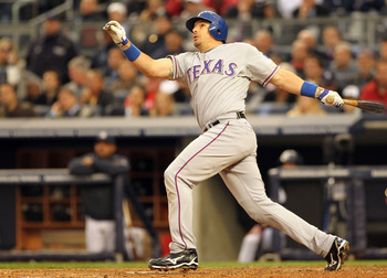 NEW YORK - OCTOBER 20: Matt Treanor #15 of the Texas Rangers hits a solo homerun against the New York Yankees in Game Five of the ALCS during the 2010 MLB Playoffs at Yankee Stadium on October 20, 2010 in the Bronx borough of New York City.  (Photo by Al