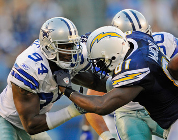 SAN DIEGO - AUGUST 21:  Line backer DeMarcus Ware #94 of the Dallas Cowboys in action against tight end Randy McMichael #81 of the San Diego Chargers at Qualcomm Stadium on August 21, 2010 in San Diego, California.  (Photo by Kevork Djansezian/Getty Image