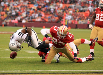 SAN FRANCISCO - OCTOBER 17:  Louis Murphy #18 of the Oakland Raiders fumbles the ball when he was hit by Taylor Mays #23 of the San Francisco 49ers at Candlestick Park on October 17, 2010 in San Francisco, California. Murphy recovered his own fumble on th