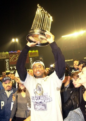 26 Oct 2000:  Bernie Williams of the New York Yankees celebrates the 4-2 win and World Series Championship over the New York Mets in five games during the World Series at Shea Stadium in Flushing, New York. &lt;DIGITAL IMAGE&gt; Mandatory Credit: Ezra Shaw/ALLS