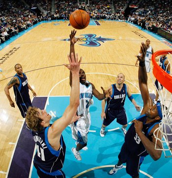 NEW ORLEANS - MARCH 22:  Darren Collison #2 of the New Orleans Hornets shoots the ball over Dirk Nowitzki #41 of the Dallas Mavericks at the New Orleans Arena on March 22, 2010 in New Orleans, Louisiana.  NOTE TO USER: User expressly acknowledges and agre