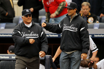 NEW YORK - OCTOBER 20:  (L-R) Former New York Yankees Bucky Dent and Aaron Boone walk onto the field to throw out the cermonial first pitch prior to the Yankees playing against the Texas Rangers in Game Five of the ALCS during the 2010 MLB Playoffs at Yan