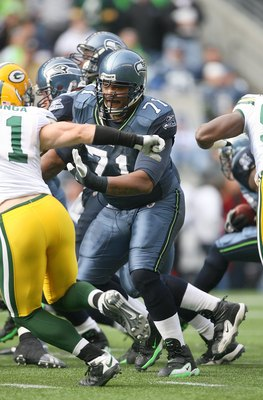 SEATTLE - OCTOBER 12:  Walter Jones #71 of the Seattle Seahawks picks up a block during the game against the Green Bay Packers on October 12, 2008 at Qwest Field in Seattle, Washington. The Packers defeated the Seahawks 27-17. (Photo by Otto Greule Jr./Ge