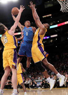 LOS ANGELES - APRIL 20:  Russell Westbrook #0 of the Oklahoma City Thunde goes up for a shot over Gasol #16 of the Los Angeles Lakers during  Game Two of the Western Conference Quarterfinals of the 2010 NBA Playoffs on April 20, 2010 at Staples Center in