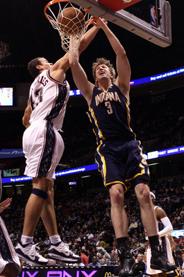 EAST RUTHERFORD, NJ - JANUARY 15:  Troy Murphy #3 of the Indiana Pacers dunks the ball against Kris Humphries #43 of the New Jersey Nets at the Izod Center on January 15, 2010 in East Rutherford, New Jersey. NOTE TO USER: User expressly acknowledges and a