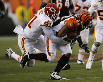 CINCINNATI - DECEMBER 27: Cedric Benson #32 of the Cincinnati Bengals is tackled by Tamba Hali #91 of the Kansas City Chiefs in their NFL game at Paul Brown Stadium December 27, 2009 in Cincinnati, Ohio.    (Photo by John Sommers II/Getty Images)