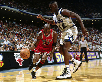 Jordan driving past a young Shaquille O'Neal