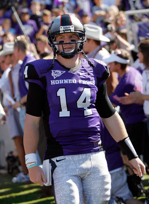 FORT WORTH, TX - OCTOBER 16:  Quarterback Andy Dalton #14 of the TCU Horned Frogs walks on the field against the BYU Cougars at Amon G. Carter Stadium on October 16, 2010 in Fort Worth, Texas. TCU beat BYU 31-3. (Photo by Tom Pennington/Getty Images)