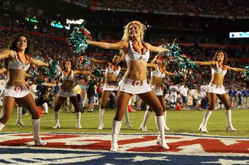 MIAMI - SEPTEMBER 21:  Cheerleaders perform during a stoppage in play as the Indianapolis Colts take on the Miami Dolphins at Land Shark Stadium on September 21, 2009 in Miami, Florida. The Colts defeated the Dolphins 27-23.  (Photo by Doug Benc/Getty Ima