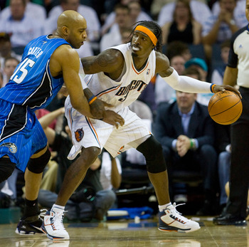 CHARLOTTE, NC - APRIL 26:  Gerald Wallace #3 of the Charlotte Bobcats tries to back down Vince Carter #15 of the Orlando Magic in Game Four of the Eastern Conference Quarterfinals during the 2010 NBA Playoffs at Time Warner Cable Arena on April 26, 2010 i