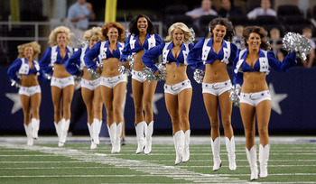 ARLINGTON, TX - AUGUST 12: The Dallas Cowboys Cheerleaders perform during the preseason game between the Dallas Cowboys and Oakland Raiders at the Dallas Cowboys Stadium on August 12, 2010 in Arlington, Texas. (Photo by Tom Pennington/Getty Images)